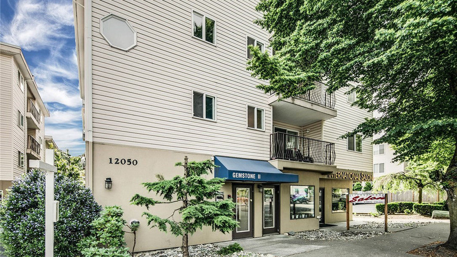 Sun-filled, spacious, top-floor condo that's an easy walk to the new light-rail station at Northgate.