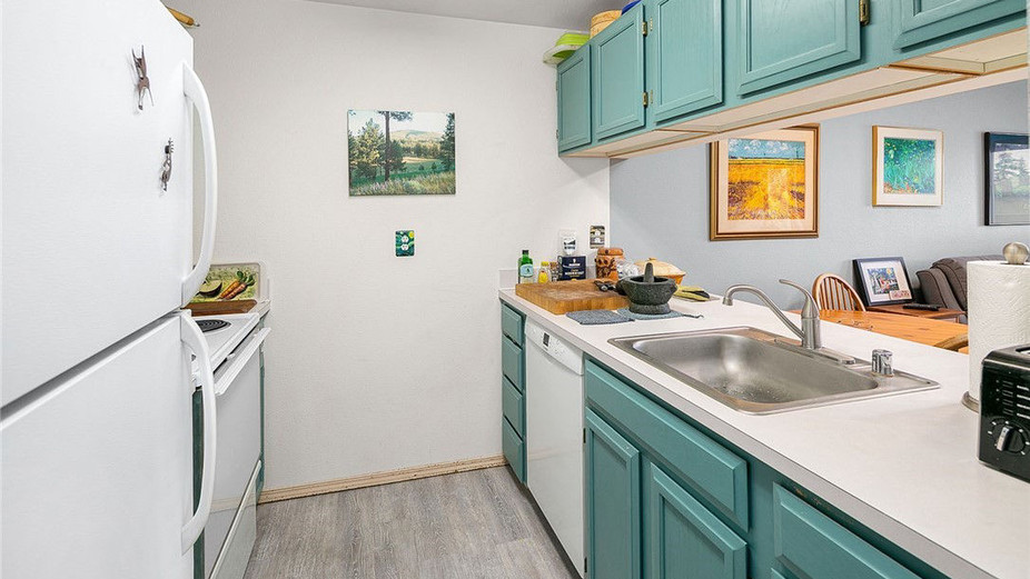 Update kitchen with all the modern amenities that opens to the dining and living rooms.