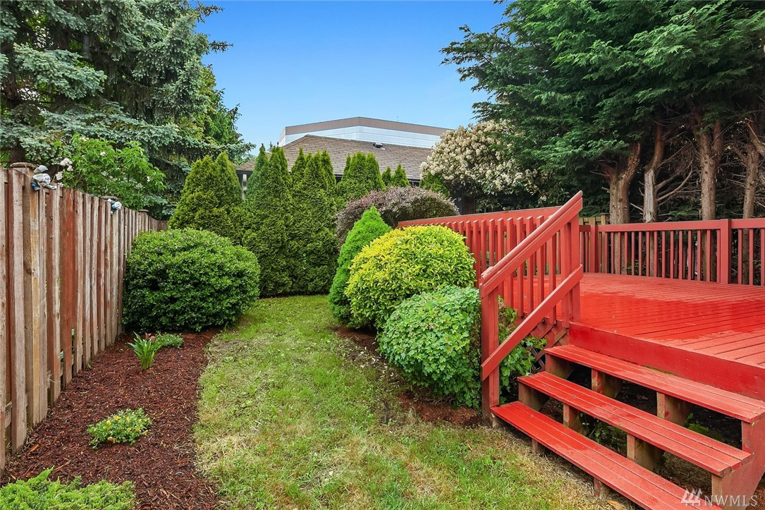 Large, beautiful, fully fenced backyard and huge deck