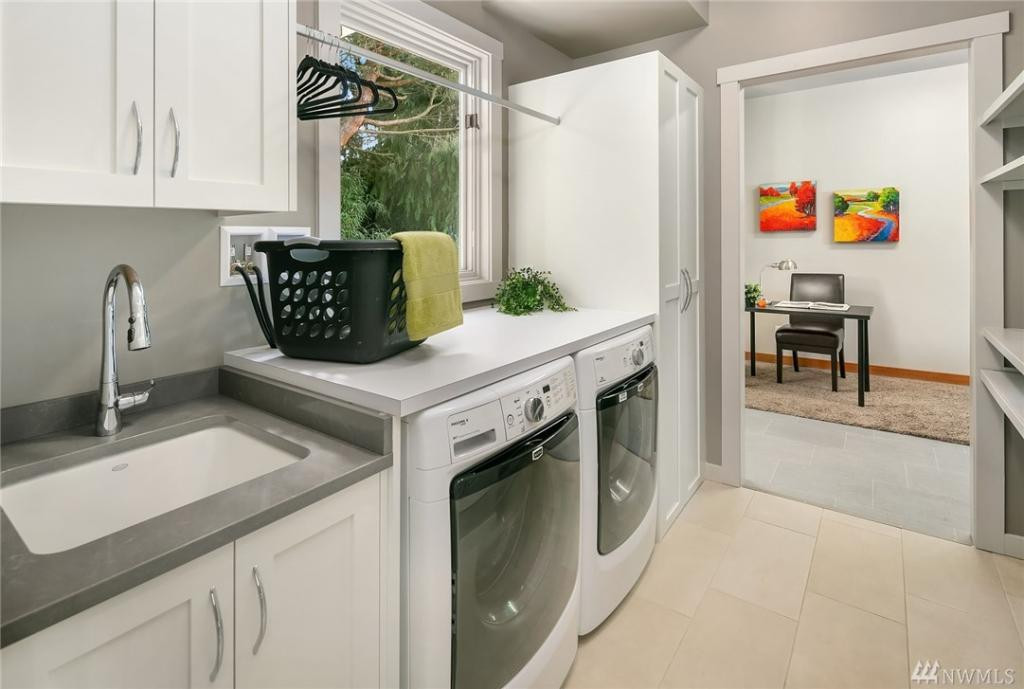 Laundry room with storage and access to the den/office