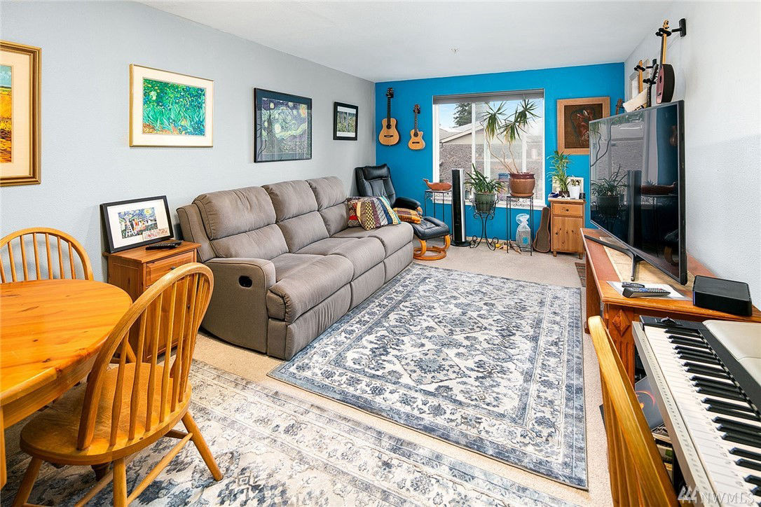 Spacious dining and living rooms with direct access to the south-facing deck - perfect for fun and entertaining. ...