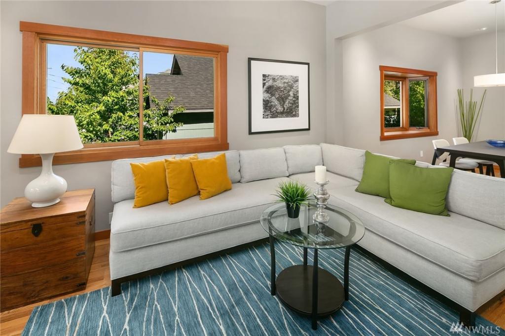 The living room with gleaming hardwood oak floors
