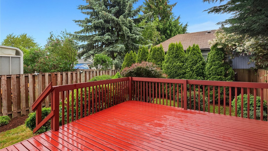 Huge deck and fully fenced, private backyard - great place to relax and entertain...