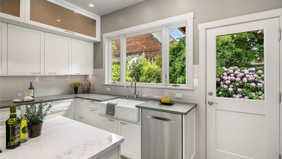 Ultra-modern kitchen with direct access to the sanctuary in the backyard...