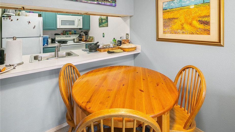 Updated kitchen with all the modern amenities that opens to the dining and living rooms.