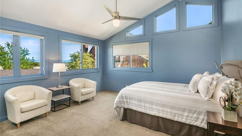 Master bedroom with cathedral ceilings, views and en-suite