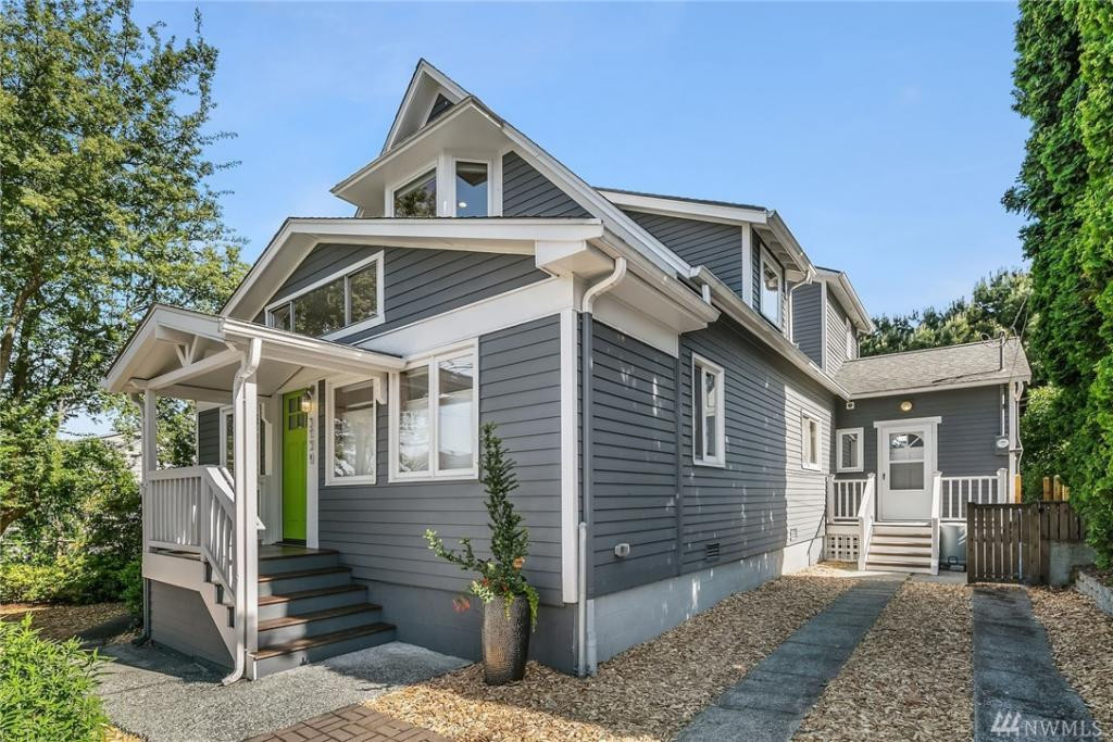Sunny, gorgeously updated storybook home on top of the 'ridge', with views of Greenlake and the Cascades, and 83 Walkscore! ...