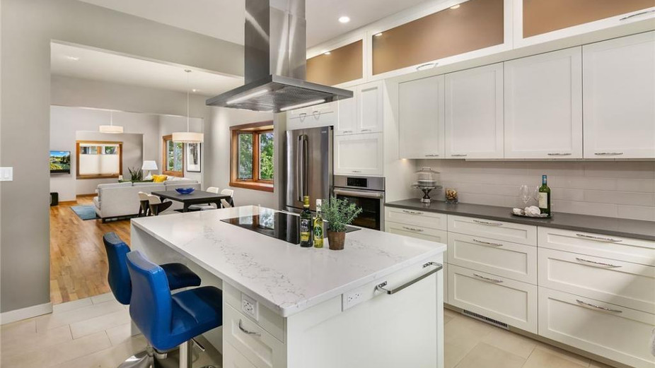 Kitchen with dining and living rooms