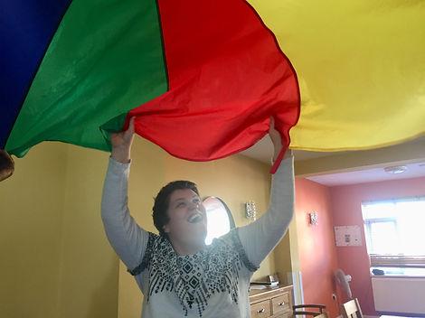 Women waving colourful sheet