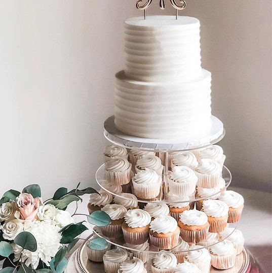 Two tiered white bridal cake with cookie