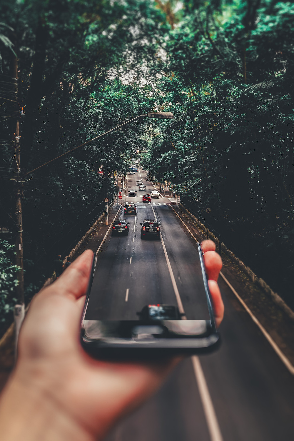 forced-perspective-photography-of-cars-running-on-road-below-799443