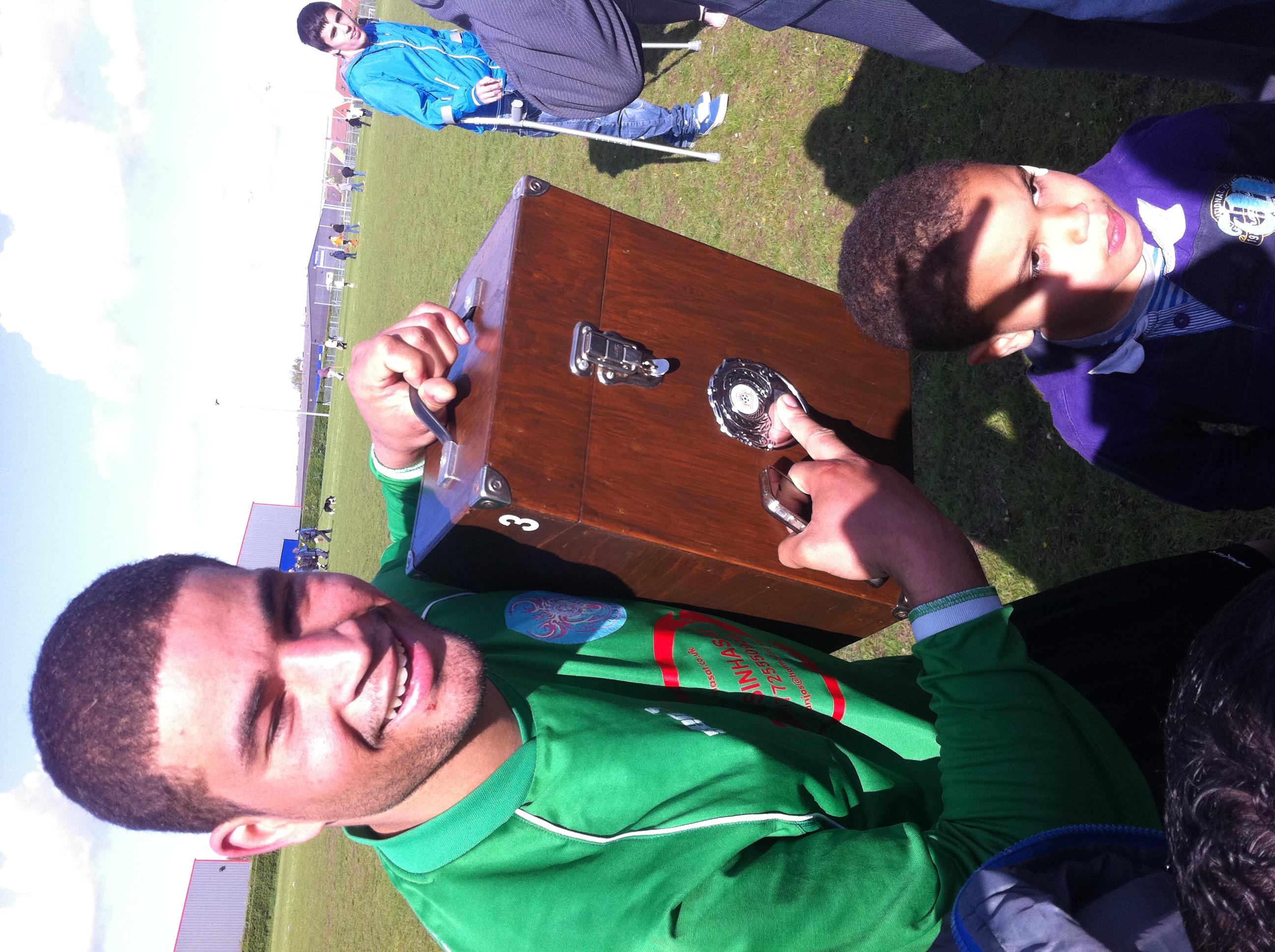 Dino enjoying the trophy