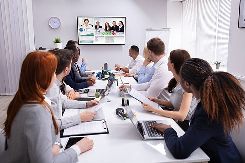 Group Of Businesspeople Having Video Con