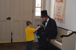 Lincoln showing a toy to child