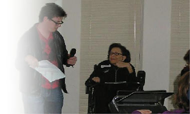 Image of interview with person in wheelchair