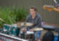 Image of - Brodie playing the drums durng a Uni Gig