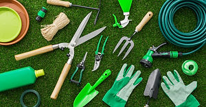 Gardening tools and utensils on a lush g
