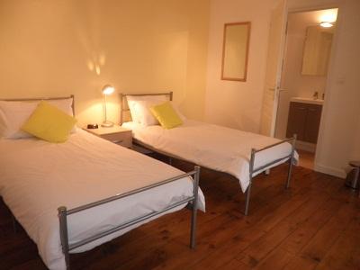 Twin bedroom yellow