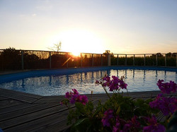 heated swimming pool and sunset