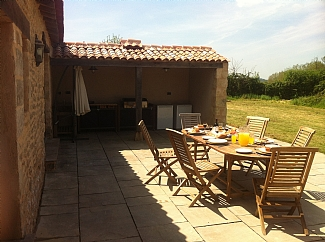 fontenay-le-comte-farm-house-french-rentals-large-patio-area-for-relaxing-eating-cooking-