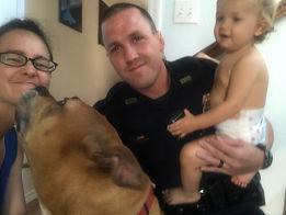 Offcer Nathan Naumann & family with Bandit