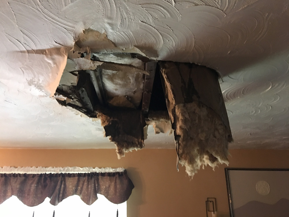 hole in sheetrock from ceiling collapsing with insulation