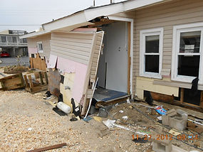 house with part of the side dislodged