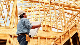 Construction worker framing a house
