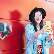 Asian fashion woman vlogging and using m