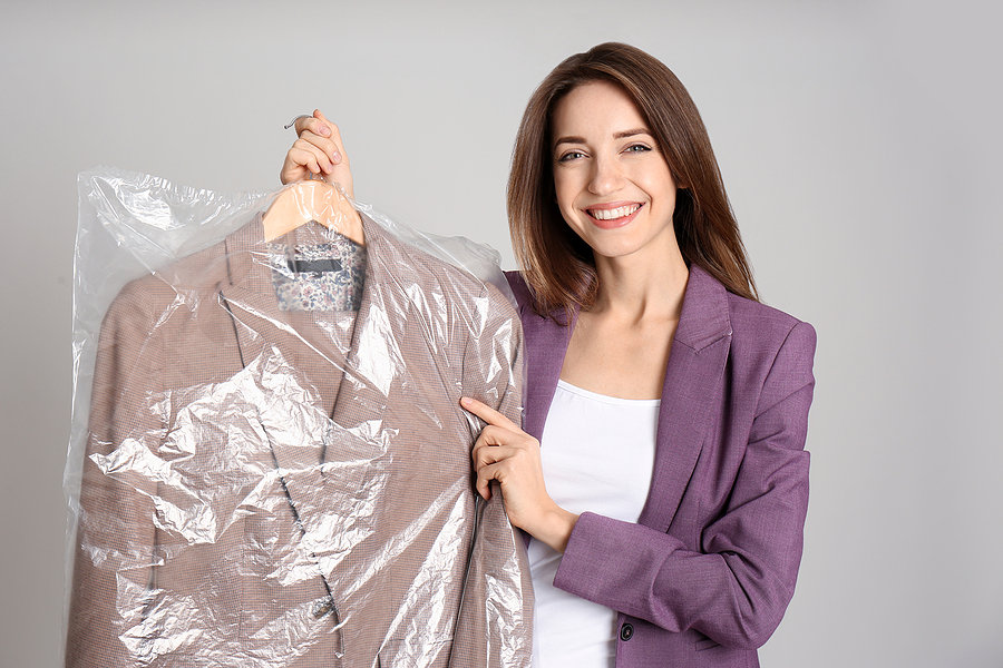 bigstock-Young-Woman-Holding-Hanger-Wit-