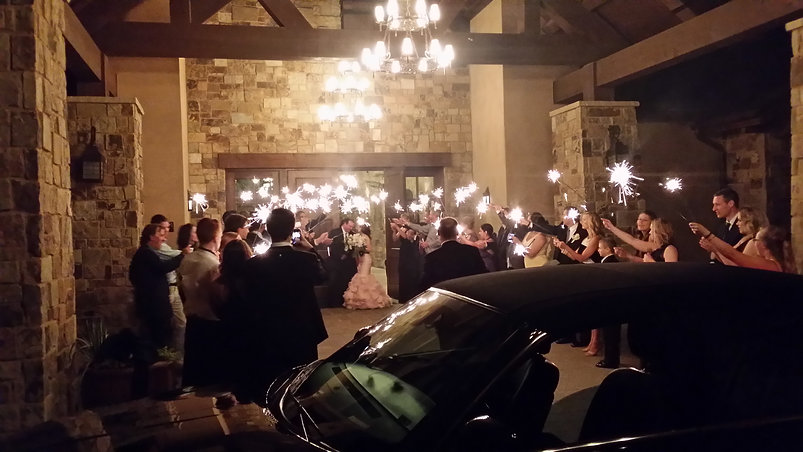 "alt= ""Anthony's town car picking up bride and groom at a wedding Denver Colorado"""