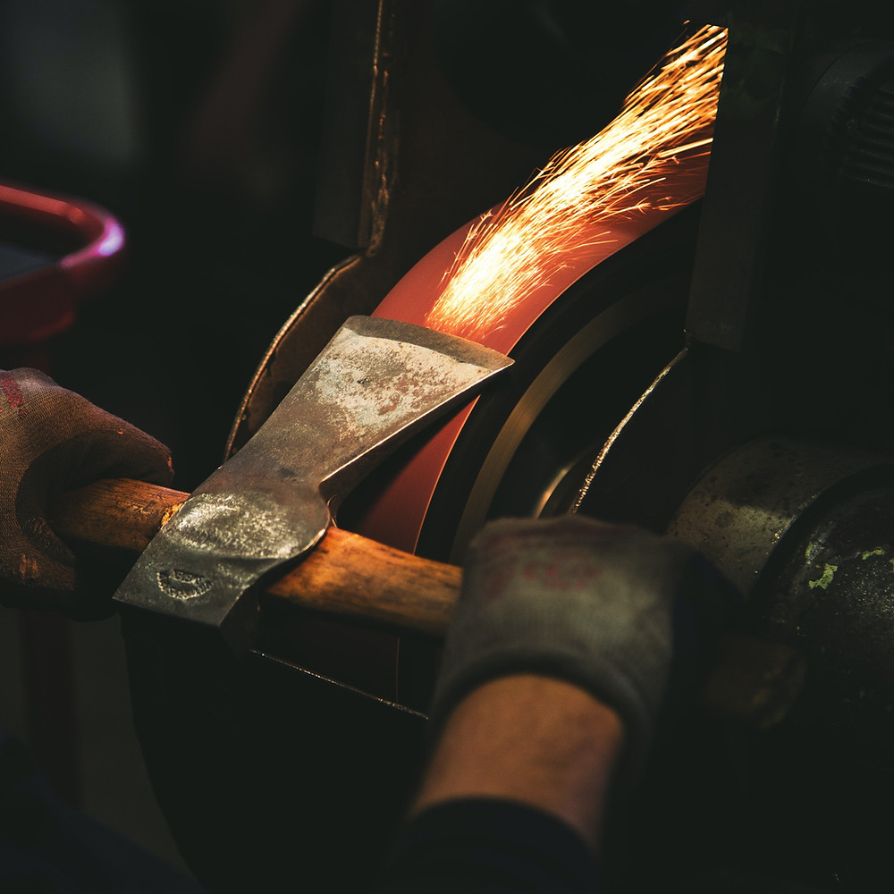 Transforming public sector procurement. Picture of an axe being sharpened.