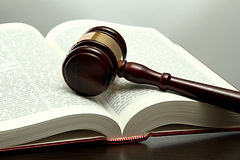 wooden gavel and book on wooden table, o