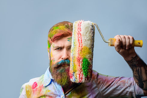 Painter. Bearded painter with paint roll
