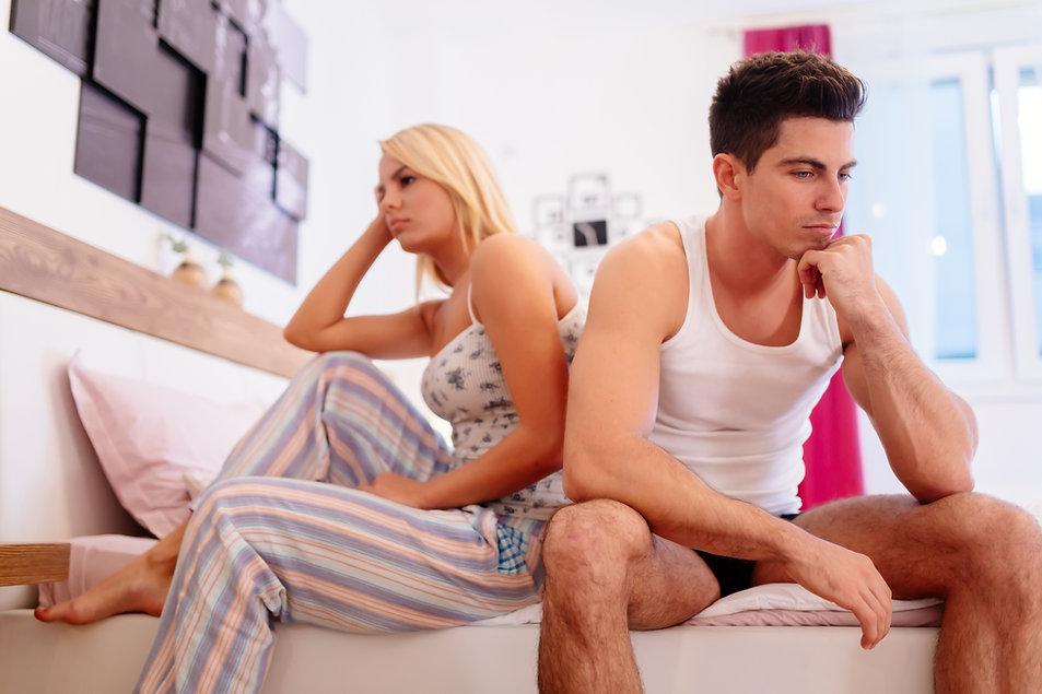 Worried couple having problems in bedroo