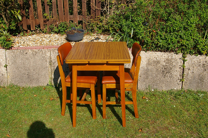 2 RETRO CHAIRS AND A KITCHEN TABLE BY P.H.G & SONS LTD GUILDFORM GUILDFORD