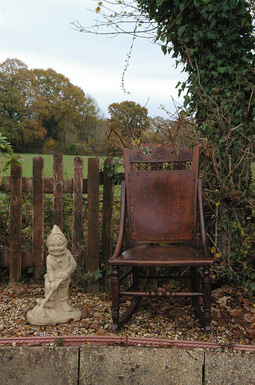 VICTORIAN OAK AND BEECH MOULDED PANELLED SEAT AND BACK ROCKING CHAIR