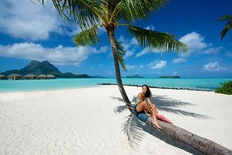 Woman celebrating divorce at Bora Bora lagoon