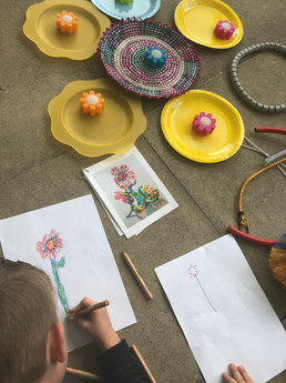 Children drawing their sculpture based on Yayoi Kusama's 'Flowers that Bloom'