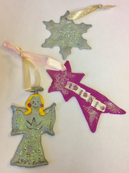 An angel, shooting star and snowflake created using polymer clay