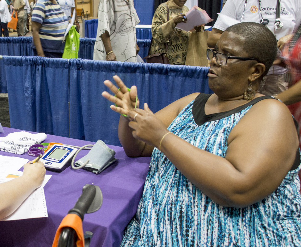 Ethel Tribue sits down with a Community Network RN during the INShape Indiana Black & Minority Health Fair on July 16 at the Indiana Convention Center. PHOTO BY DANIELLE BEHRENS