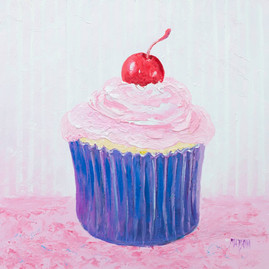 Cupcake with strawberry frosting and a cherry