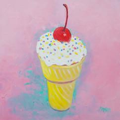 Ice cream cone with cherry on top