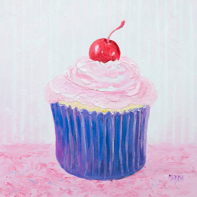 Cupcake with strawberry frosting and cherry
