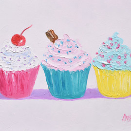 Three Frosted cupcakes