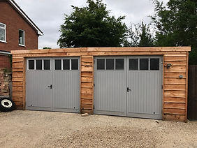 Garage with waney edge cladding.jpg