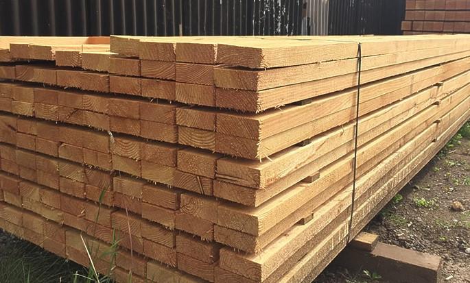 Freshly cut larch post & rail fencing