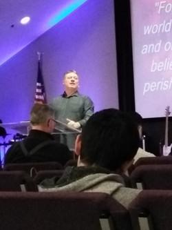 Pastor Larry preaching