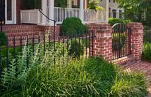 brick walk, columns, wrought iron gate and fence, perennials