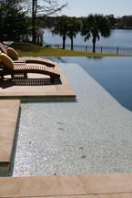 sun shelf in vanishing edge pool on the river